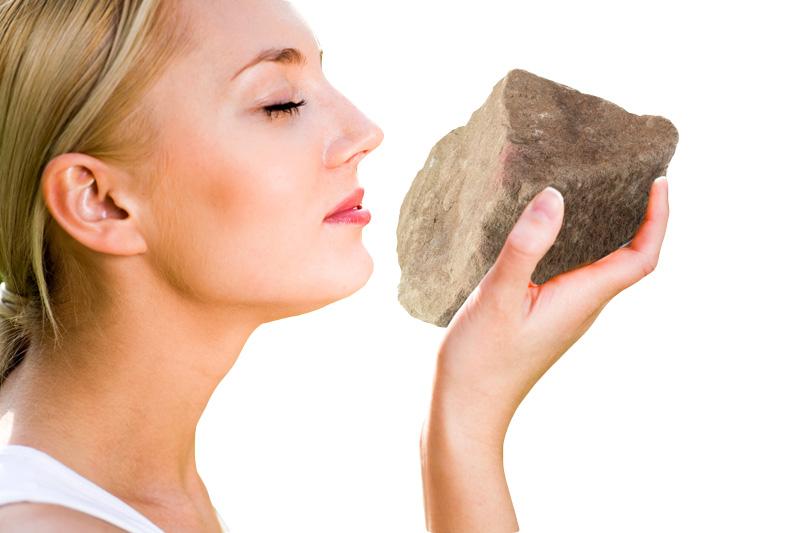 womansmellingrock.jpg